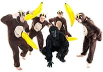 four stag monkeys attacking a stag gorilla with inflatable bananas