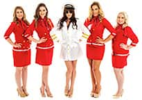 sexy female pilot and air hostesses with hands on hips