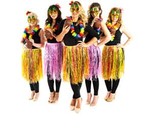 Five women in hawaiian skirts, floral garlands and sunglasses