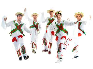 Five men dancing in Morris Dancer costumes