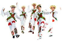 five men dressed up and doing a morris dance