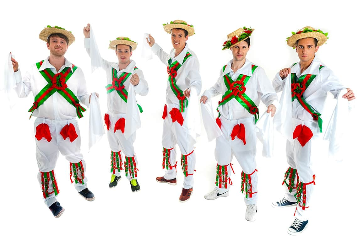 five men doing a jaunty morris dance