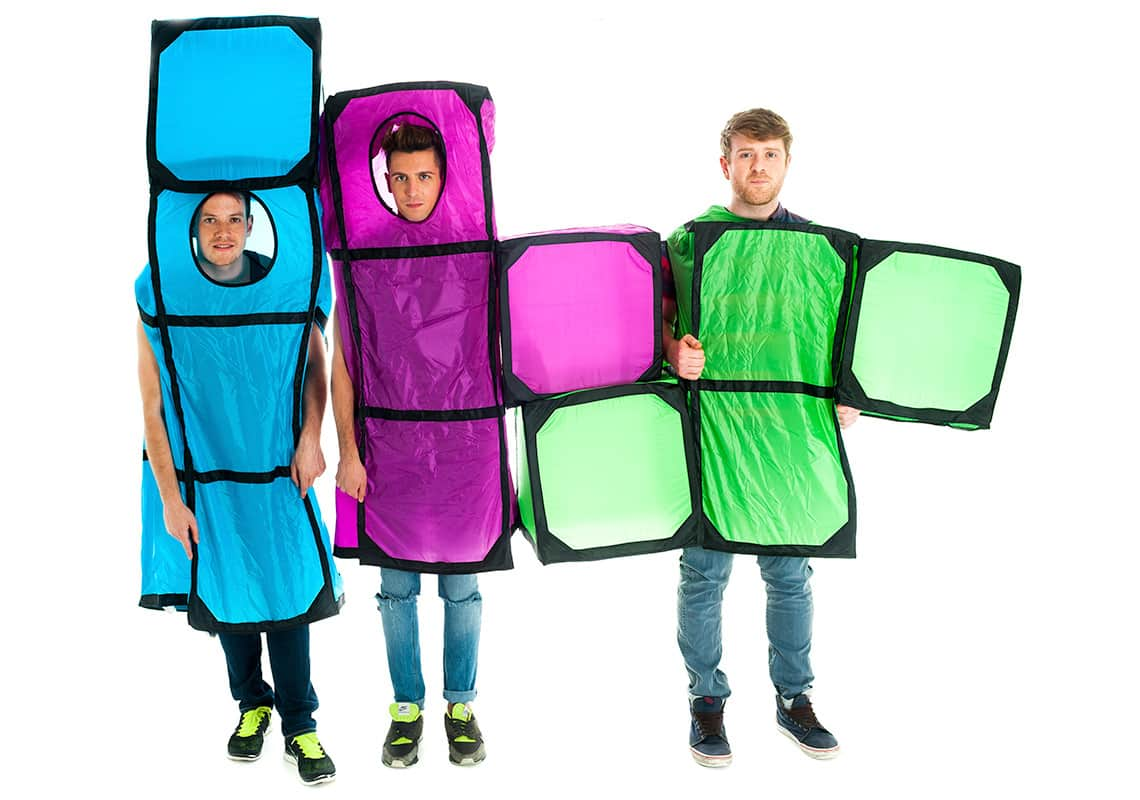three men dressed as giant Tetris shapes