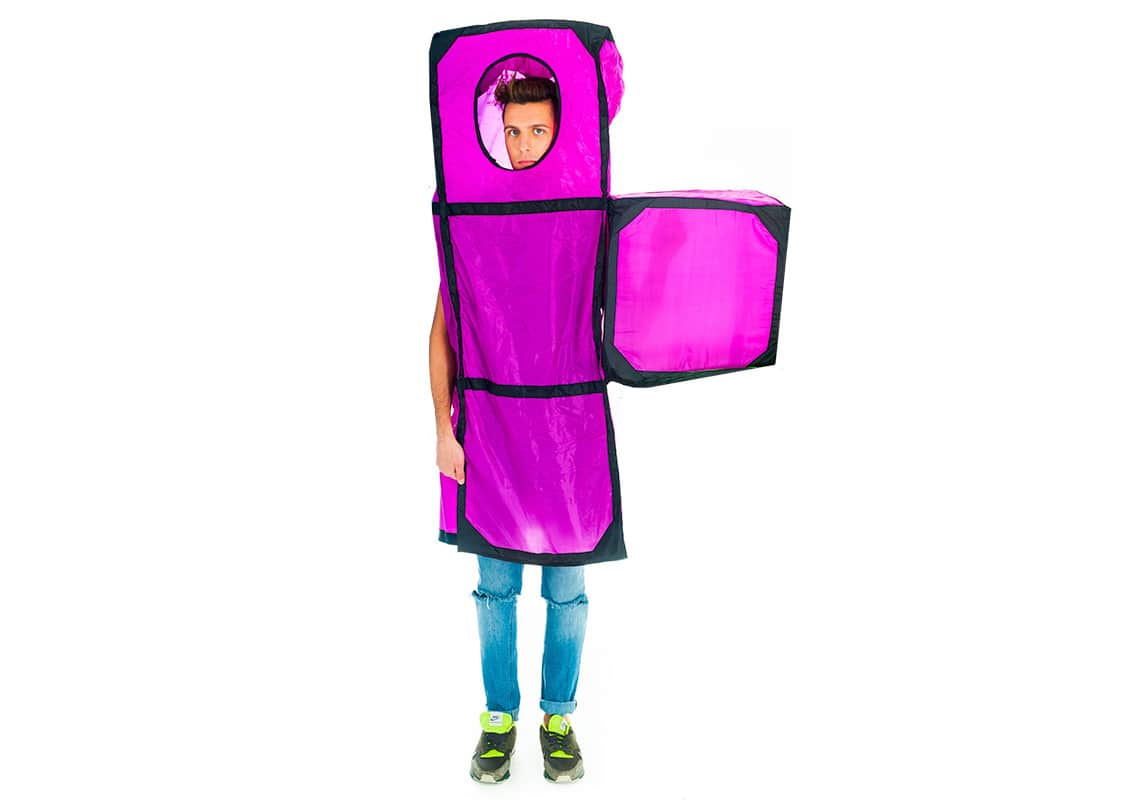A man dressed as a giant purple Tetris piece