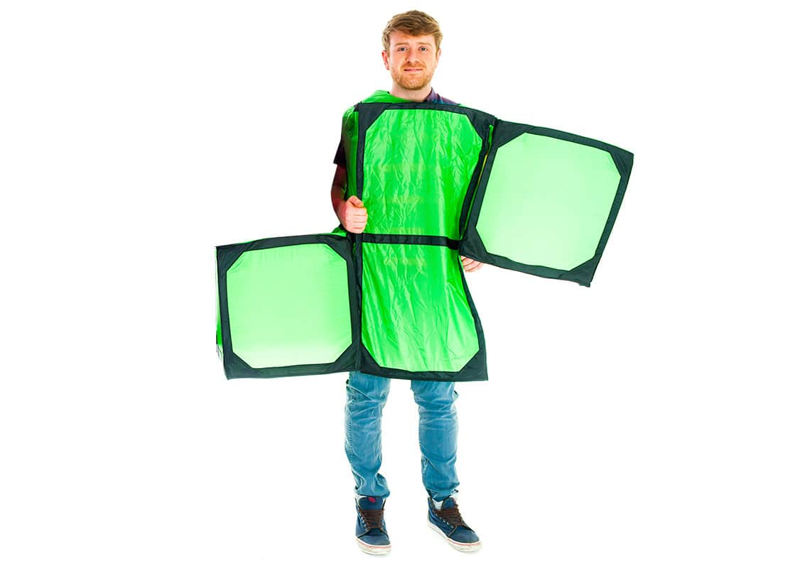 A man dressed as a giant green Tetris piece