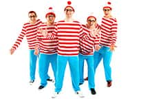 A group of guys dressed as Where's Wally and smiling
