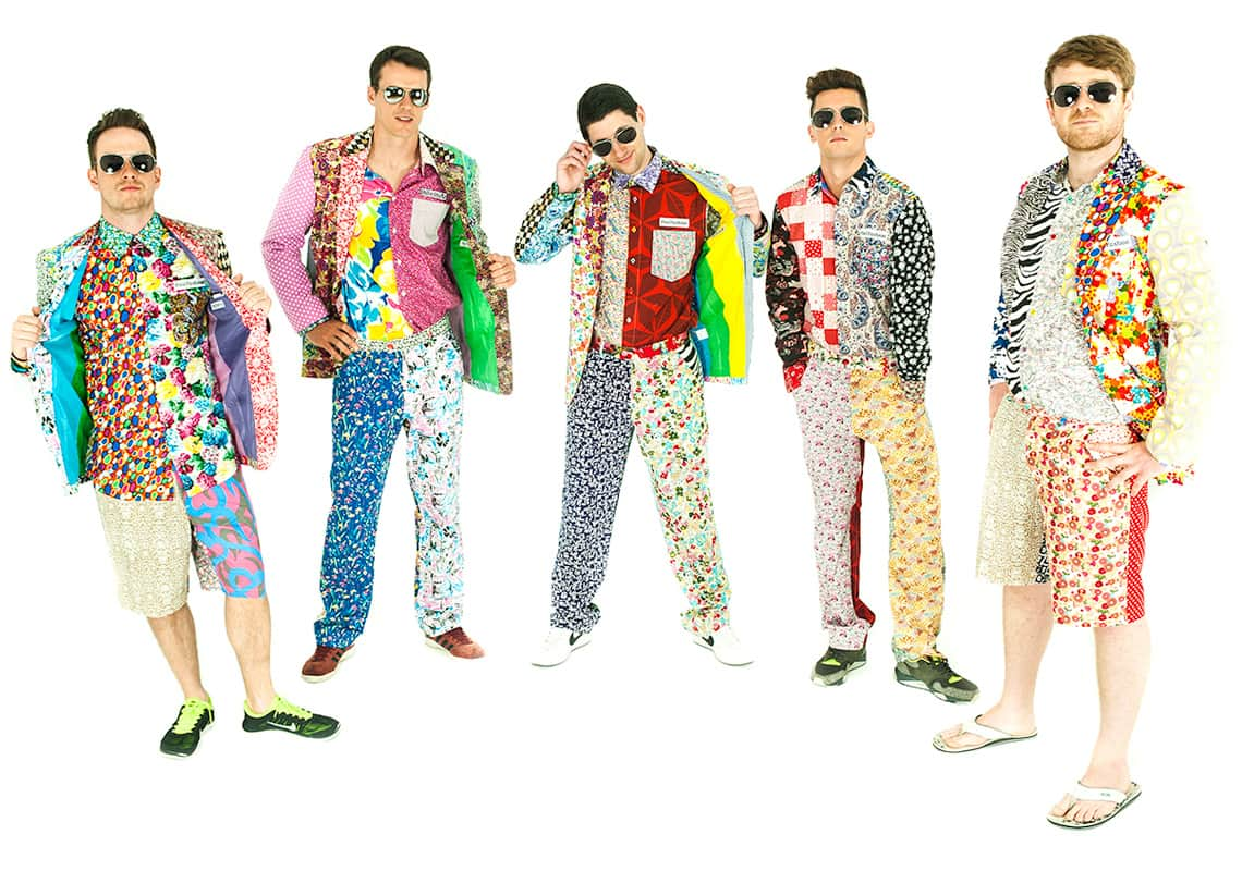 five men trying to look cool in clashing patterned outfits