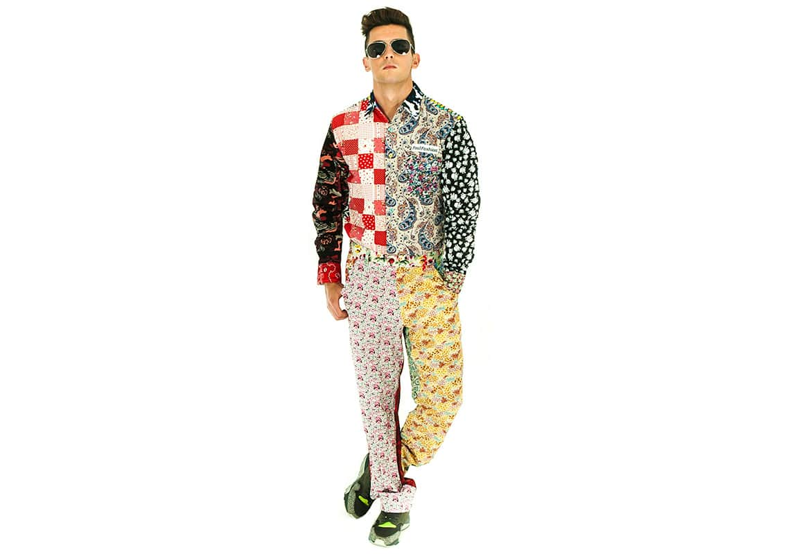 a man trying to look smooth in a hideous patterned outfit