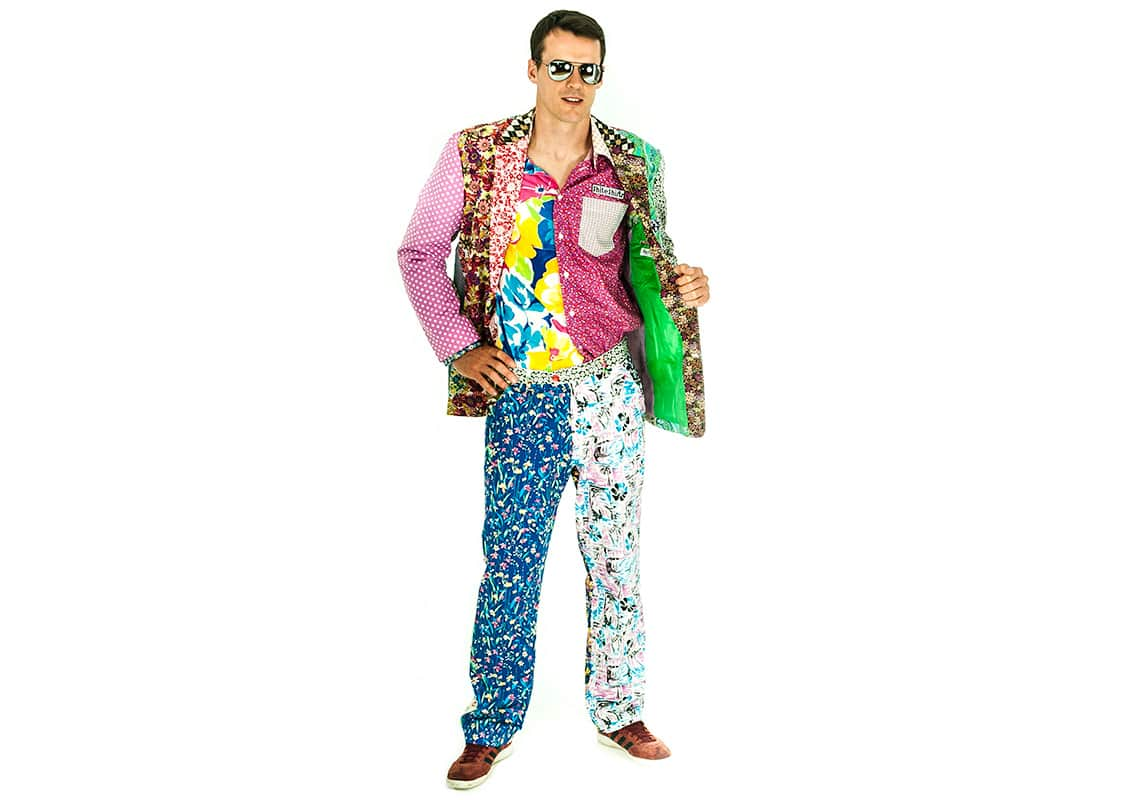 a man opening his foul patterned jacket