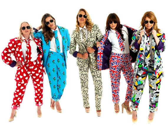 five women in colourful patterned suits