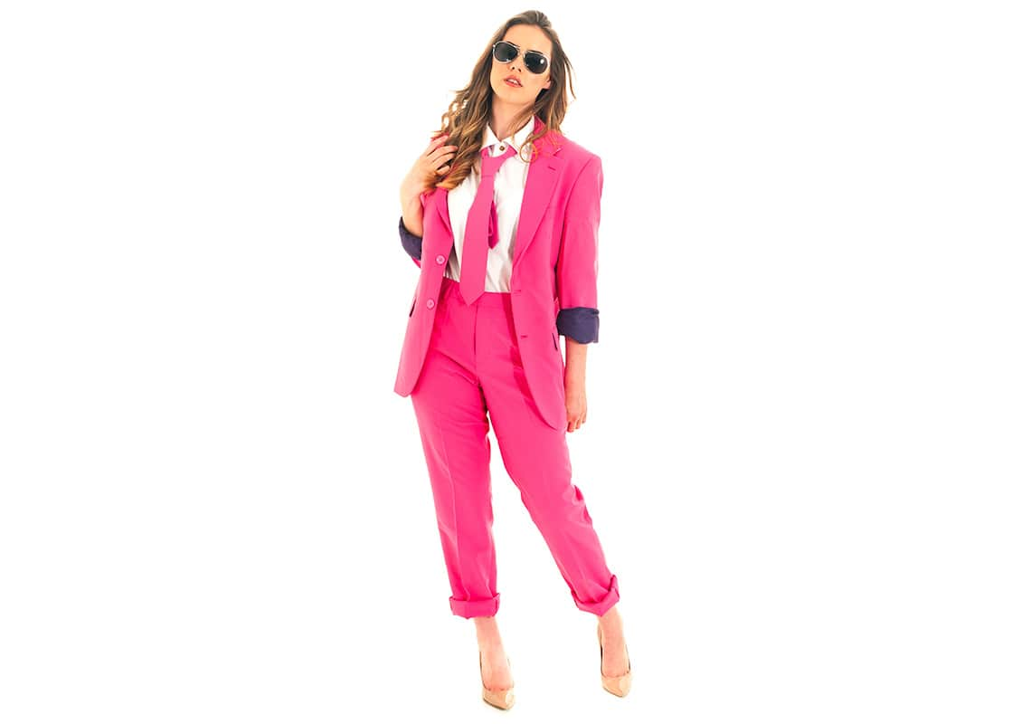 beautiful woman in masculine tailored pink suit