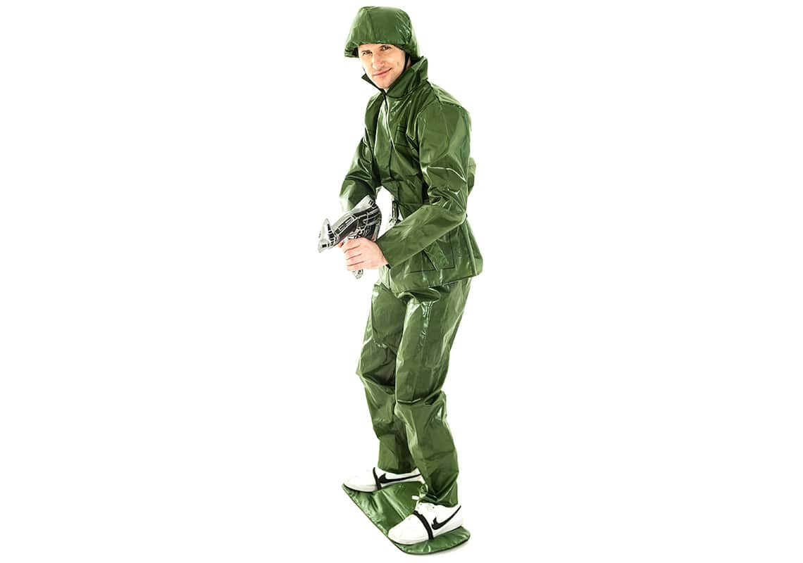 A man posing in a Toy Soldier costume