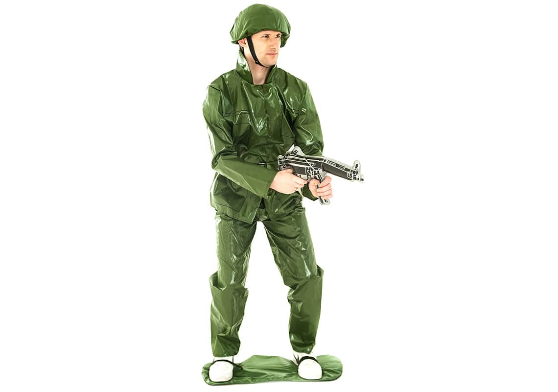 A man posing in a Toy Soldier costume with an inflatable gun