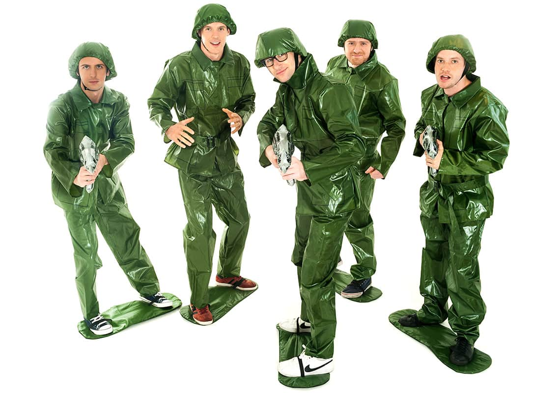 five men posing in Toy Soldier costumes with an inflatable gun