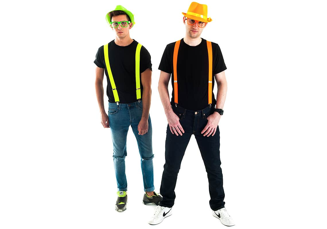 Two men in neon orange and green braces, glasses and hats
