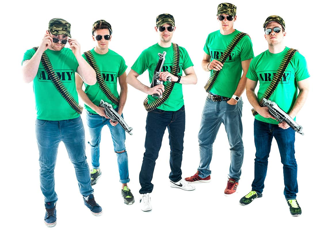 a stag group of five men in bright green army t-shirts, camouflage hats, bullet sashes and aviator sunglasses