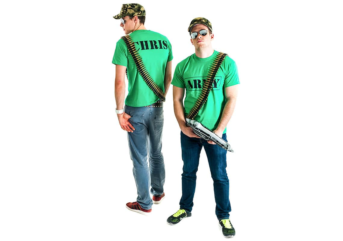 two men in army t-shirts with sunglasses, caps, bullet sashes and inflatable guns