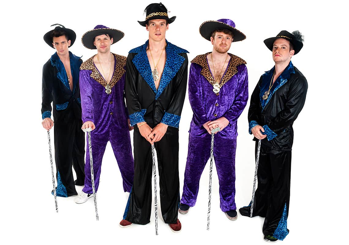 five men in black and purple pimp costumes