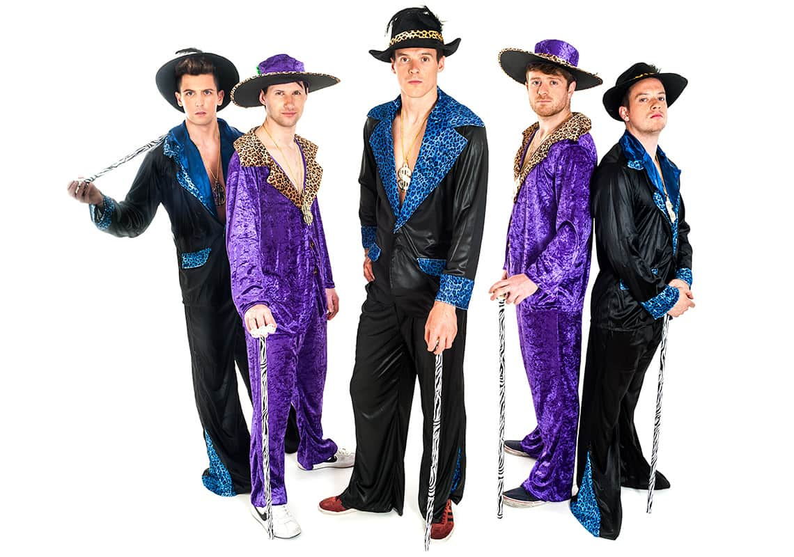 five men in purple and black pimp costumes with canes