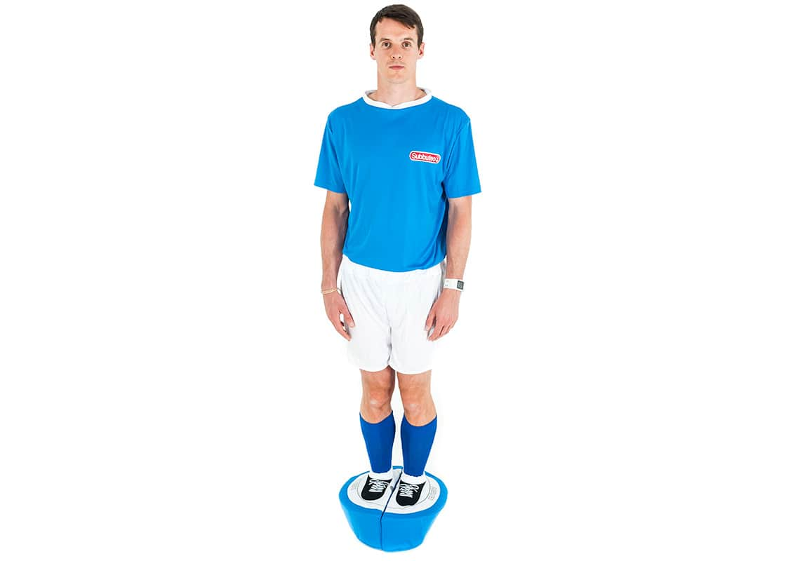 a man in a blue Subbuteo player costume