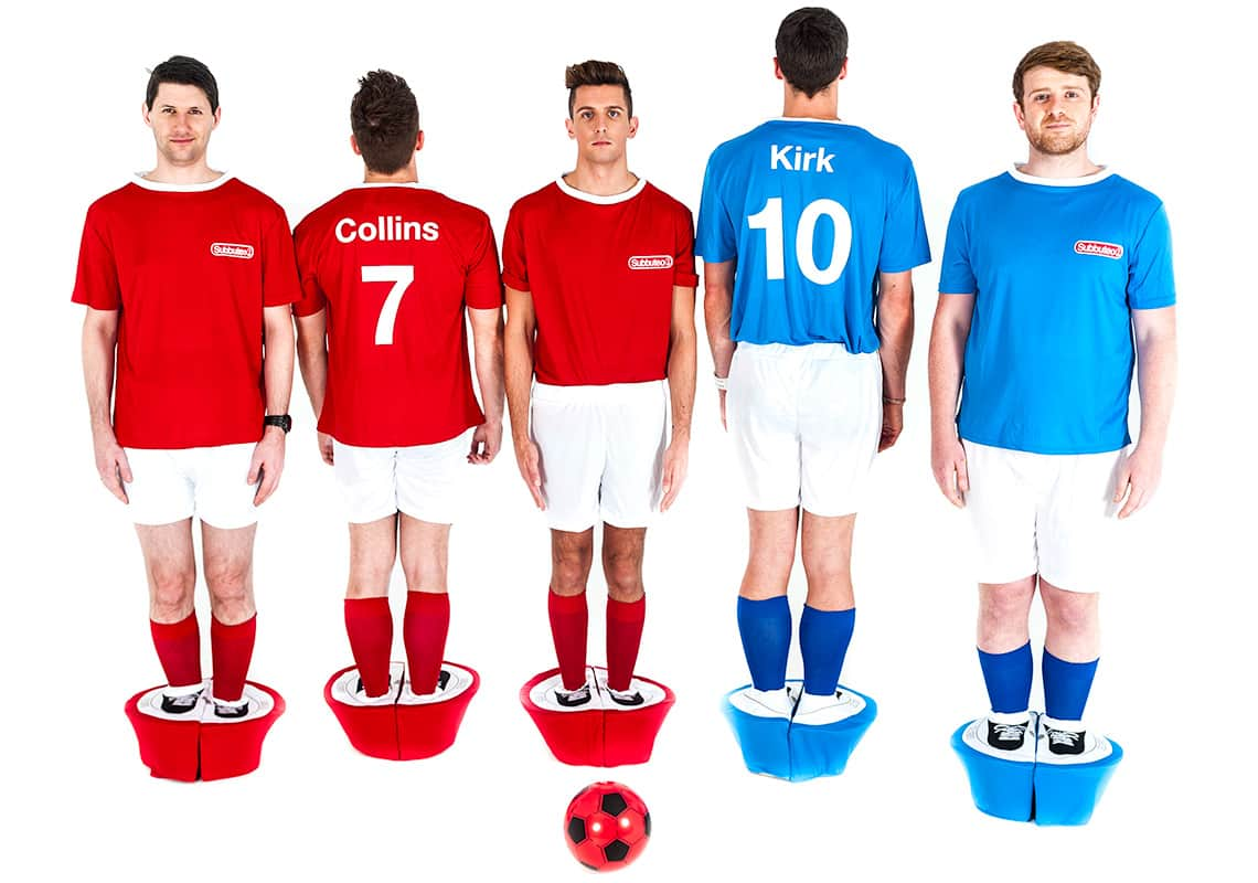 five men, front and back, showing their personalised t-shirts of their Subbuteo costumes