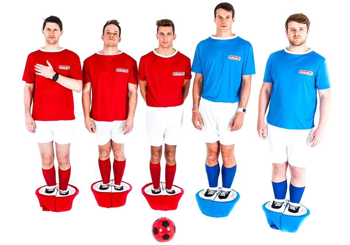 Five men standing tall in their Subbuteo costumes