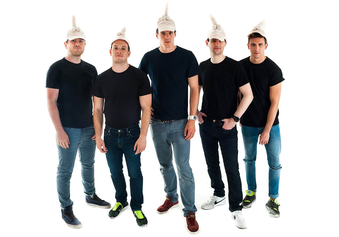 five men wearing penis caps