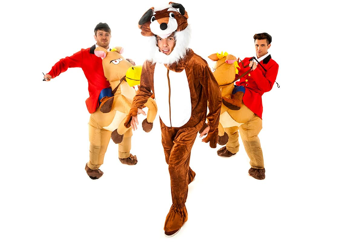 a man in a fox costume being chased by two hunters on inflatable horses