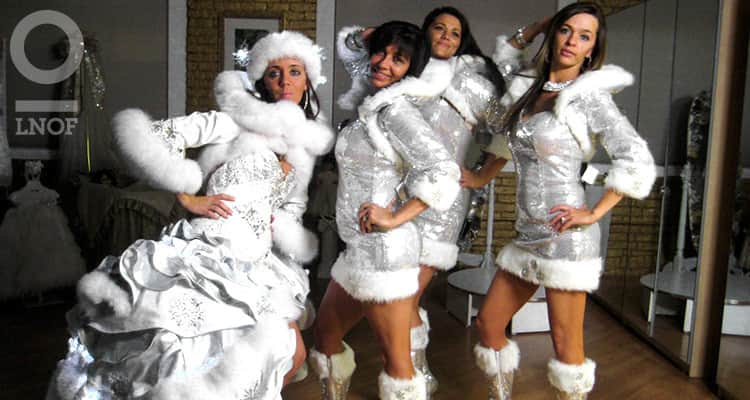 Bridesmaids dressed in silver santa-style outfits