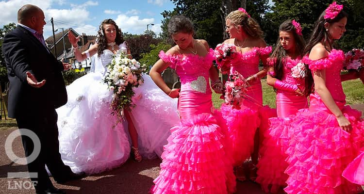 Gypsy bride and bridesmaids in neon pink fishtail dresses