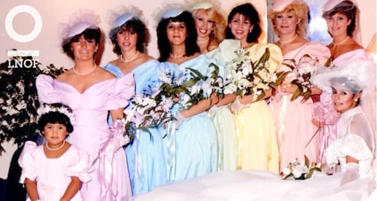 Bridesmaids in 1980s puffed sleeve dresses all the colours of the rainbow