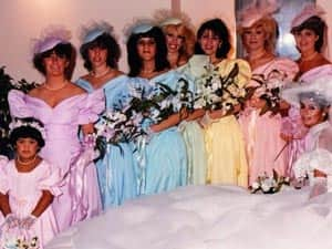 1980s bridesmaids in poufy-sleeved rainbow coloure