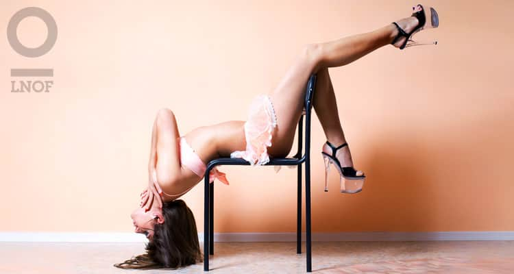 Stripper on chair with big shoes