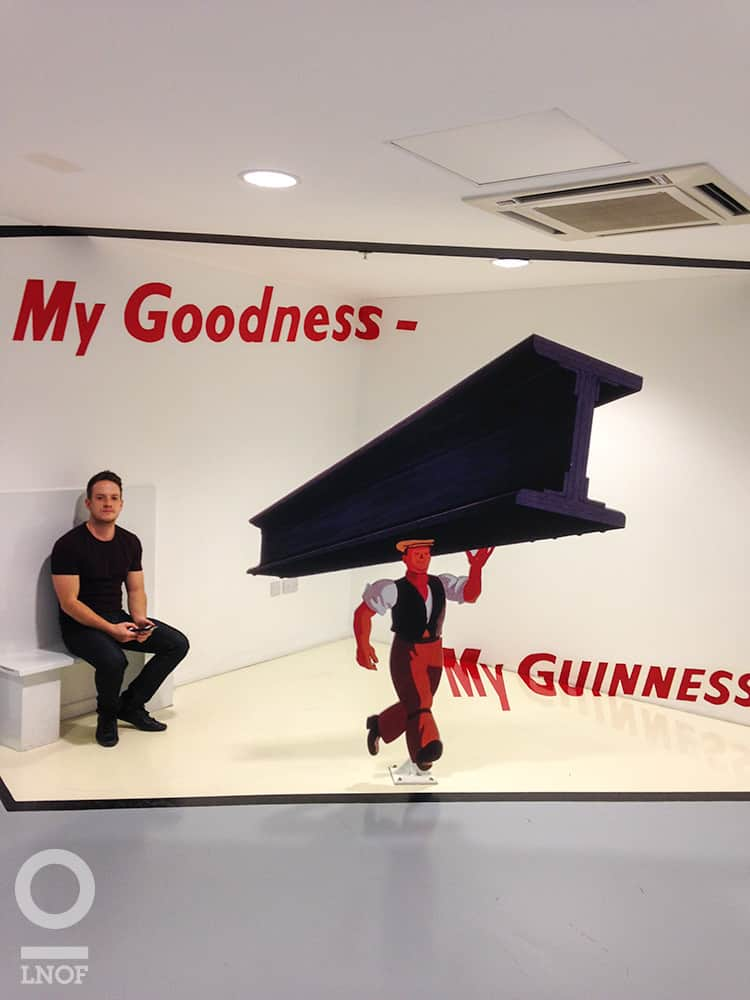 Paul in front of Guinness poster