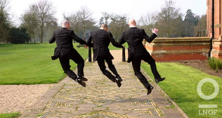 Groomsmen jumping for joy