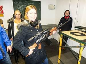Cheryl holding a rifle