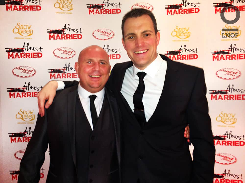 Two men posing on the red carpet at the film premiere of Almost Married