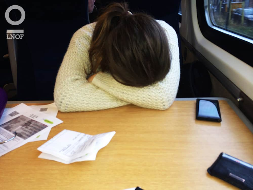 A woman with her head down on a train table