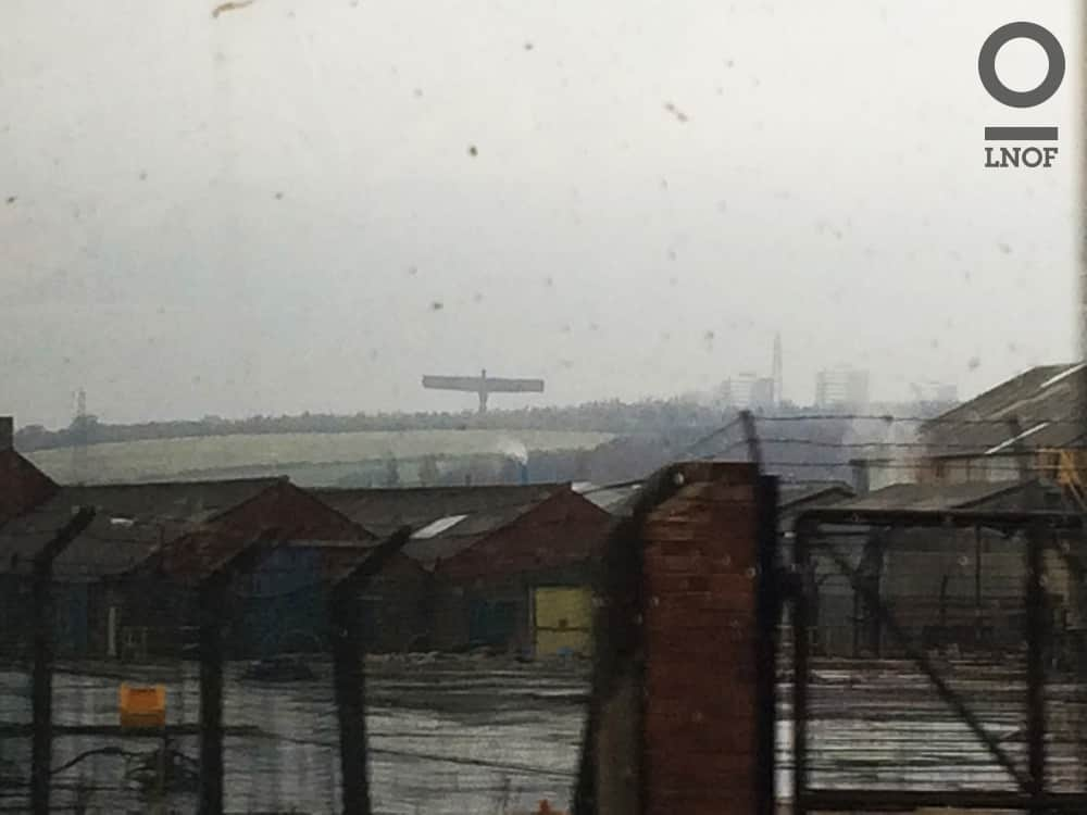 The Angel of the North and surrounding area, visible through a train window