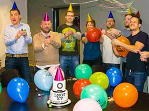 LNOF staff pulling party poppers for 15th birthday