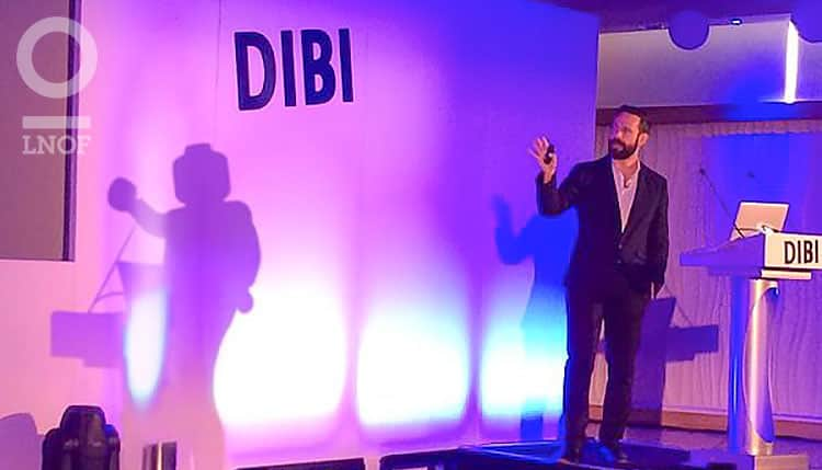 A man on stage at a DIBI conference