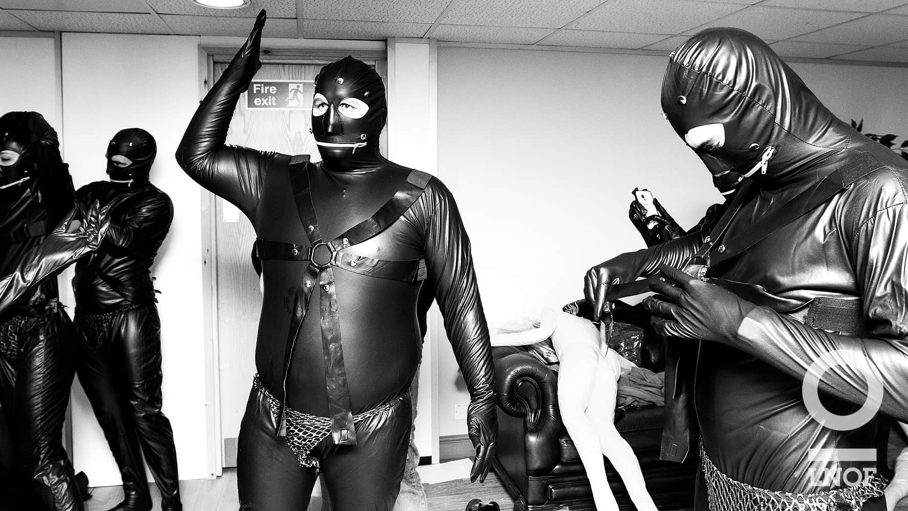 Staff getting dressed up in our very own gimp outfits for their 15 seconds of fame