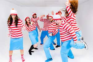 Eight staff dressed as Where's Wally improvising for the camera
