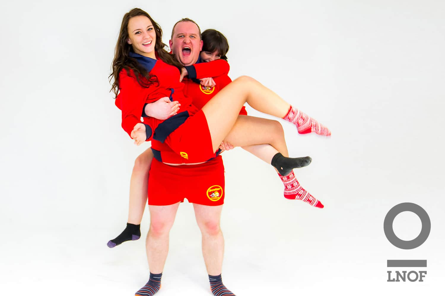 Andrew from sales shows the lifeguard strength in carrying two colleagues to safety