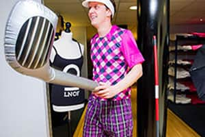 Golfers with inflatable golf clubs