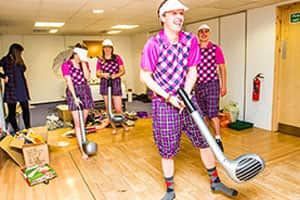 Golfers all waiting in their outfits for their scene in the video