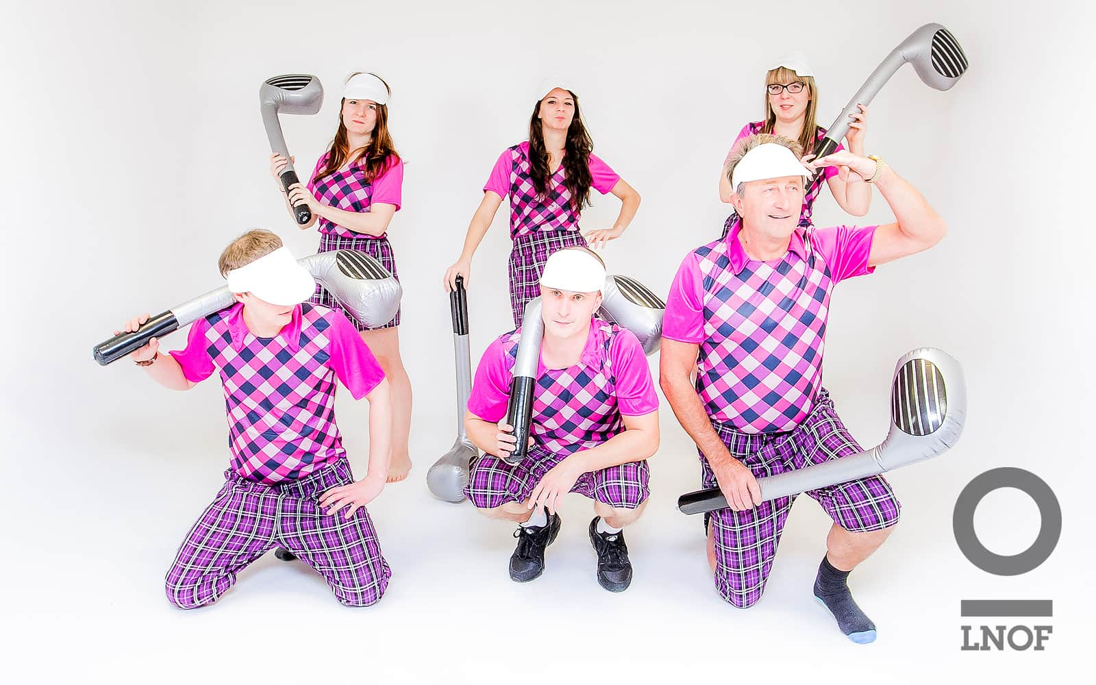 Golfers try and create a serious look for the camera in their outfits