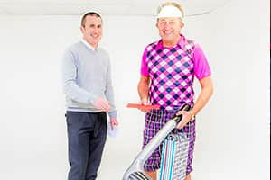 Director Andy presents Kev with birthday gifts from the office, while he is dressed as a golfer