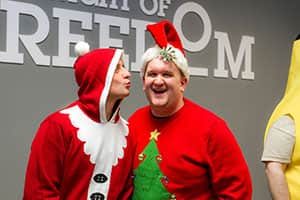 Even Santa can't resist spreading joy under the mistletoe