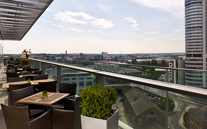 The outdoor terrace with tables and chairs on at the Doubletree by Hilton, Leeds